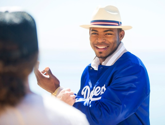 Behind the scenes with Yasiel Puig during his Starter photo shoot. (Photo by Colin Young-Wolff/Invision for Iconix/AP Images)