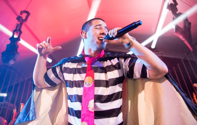 Nick Jonas performs as the 'Hamburgular' during the 2015 Maxim Halloween Party at the Beverly Hills Estate, Beverly Hills, CA on October 24, 2015. Stoli, THE Vodka, served as the official liquor of the 2015 Maxim Halloween Party.(Photo by Colin Young-Wolff/Invision for Stoli/AP Images)