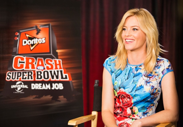 "Actress Elizabeth Banks helps the Doritos brand kick-off the ninth installment of the Crash the Super Bowl contest, on Wed., Sept. 3, 2014 in Los Angeles. Fans from participating countries around the world are invited to enter their homemade 30-second Doritos ads as part of this year's competition for the chance to see those ads air during the Super Bowl broadcast. One lucky fan – based on consumer votes - will win the grand prize: a ""dream"" job working onsite at Universal Pictures in Hollywood and $1 million. See full rules and enter at Doritos.com between September 12 and November 9. (Photo by Colin Young-Wolff/Invision for Doritos/AP Images)"