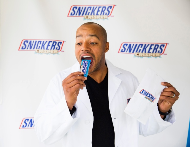 Fans were greeted by actor Donald Faison at The Grove in Los Angeles on Tuesday, February 23, 2016, as he diagnosed their social hunger symptoms and sampled the new SNICKERS® Crisper - filled with crisped rice, peanuts and caramel covered in milk chocolate. Colin Young-Wolff/AP Images for SNICKERS Brand.